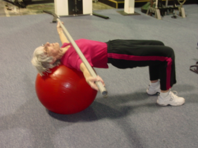 Dorthy performing supine lateral ball roll
